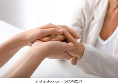 Hands of young and elderly woman. Concept of support