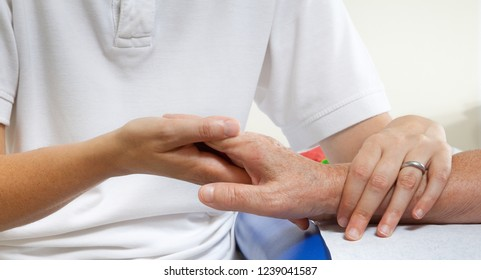 Hands of young and elderly women in a hospital or surgery