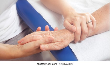 Hands of young and elderly women in a hospital or surgery (with photographic effect)