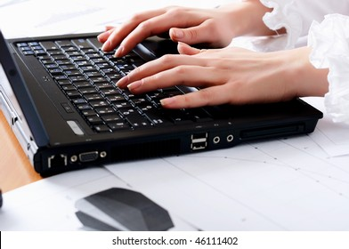 hands of a young girl working on laptop. Workplace businessman.