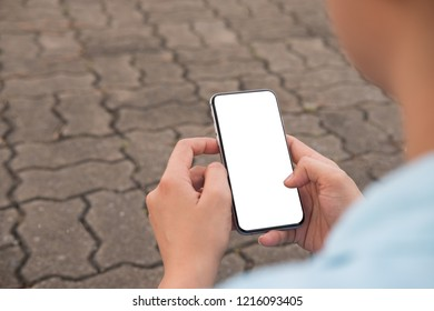 Hand's young hipster woman using smart phone on brick road.