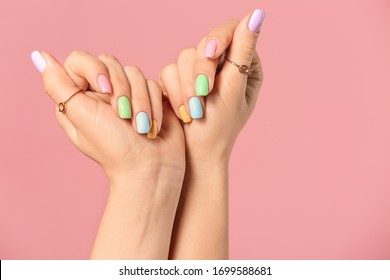 Hands of young woman with beautiful manicure on color background
