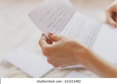 Hands of young woman holding handwritten letter