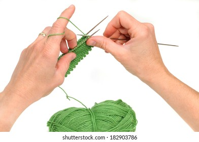 Hands of a young woman knitting