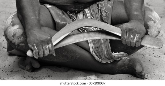 Hands of Yugambeh Aboriginal warrior man  holds boomerangs during Aboriginal culture show in Queensland, Australia.