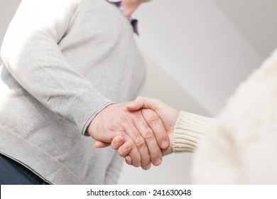Handshake of adult man and young woman