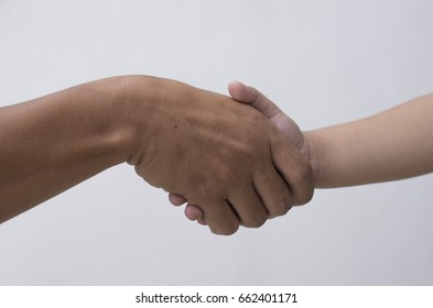 Handshake of adults and children to show a trust. Handshake background.