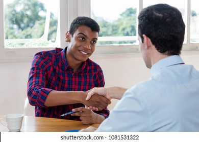 Handshake of african american male apprentice after job interview at office of company
