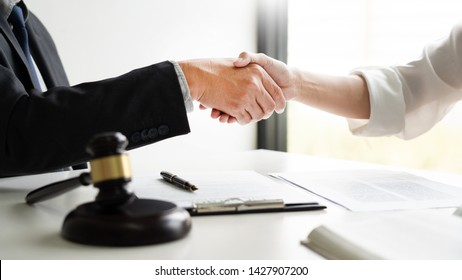 Handshake after cooperation between attorneys lawyer and clients discussing a contract agreement hope of victory over legal fighters, Concepts of law, advice