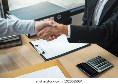 Handshake after finishing conversation Businessman sending a resignation letter to employer boss in order to resign dismiss contract, changing and resigning from work concept.