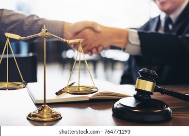 Handshake after good cooperation, Consultation between a male lawyer and businessman customer, tax and the company of real estate concept.