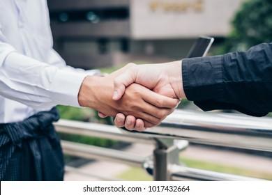 Handshake agreement of business partnership of asean economics community