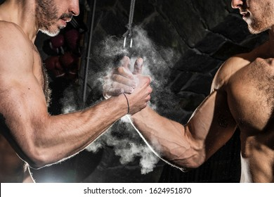 Handshake arm wrestling style. Strong and muscular arms. Friendly handshake gesture concept. Friends or competitor.