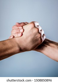 Handshake, arms. Friendly handshake, friends greeting. Male hand united in handshake. Two hands, isolated arm, helping hand of a friend.