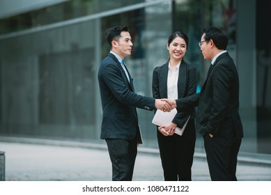 Handshake Asian  Businessman with Business partner - Business Teamwork Meeting and Discussion Together