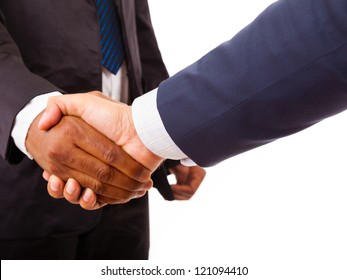 Handshake between african and a caucasian business man, isolated on white