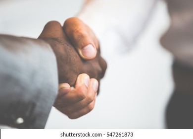 Handshake between african and a caucasian man