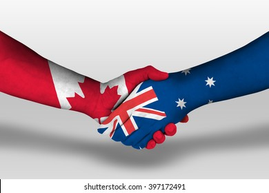 Handshake between Australia and canada flags painted on hands, illustration with clipping path.