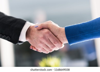 Handshake between businesswoman and businessman