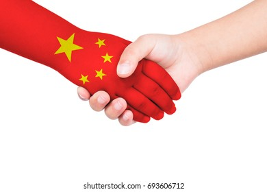 Handshake between a child and China with flags painted on hand in isolated white background