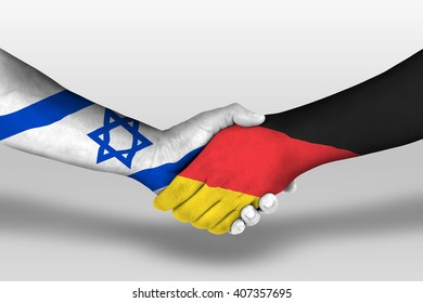 Handshake between germany and israel flags painted on hands, illustration with clipping path.