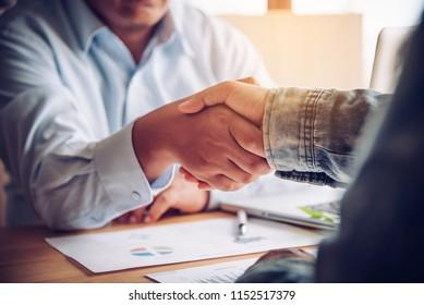 Handshake between joint venture businessmen after good management and have good concept