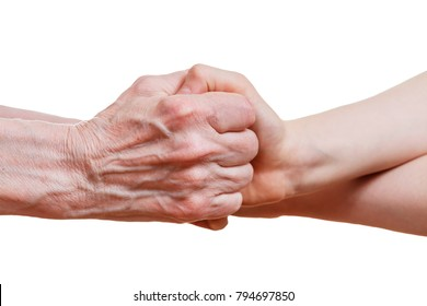 Handshake between an old person with a wrinkled hand and a kid, isolated on white background.