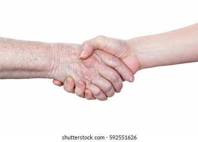 Handshake between an old woman with a wrinkled hand and a young woman isolated on white background