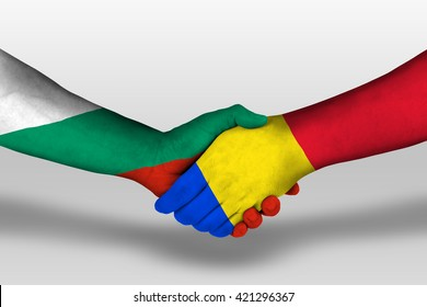 Handshake between romania and bulgaria flags painted on hands, illustration with clipping path.