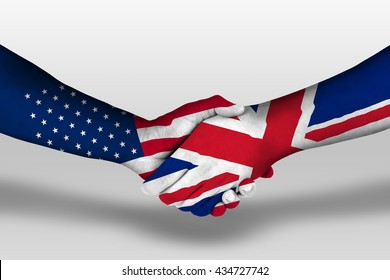 Handshake between united kingdom and united states of america flags painted on hands, illustration with clipping path.