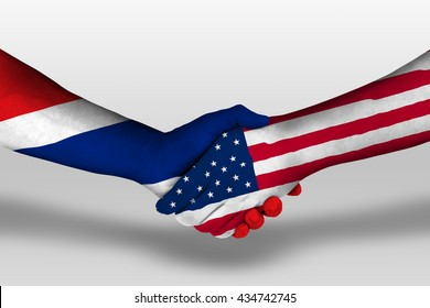 Handshake between united states of america and thailand flags painted on hands, illustration with clipping path.