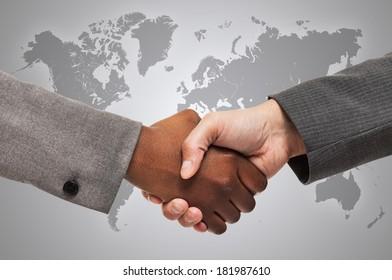Handshake between white and black business people