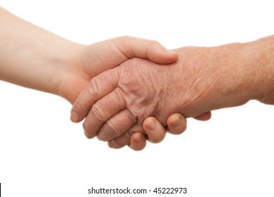 Handshake - between young and old  females on white background