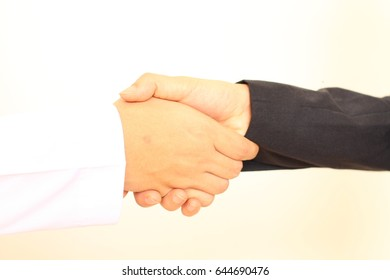 handshake for business agreement after meeting in modern social life, black and white handshaking of people.