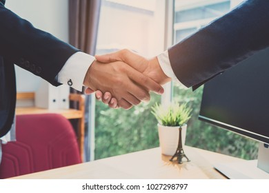 Handshake of business office partnership businessman shaking hands colleagues and greeting join in working place collaboration meeting concept