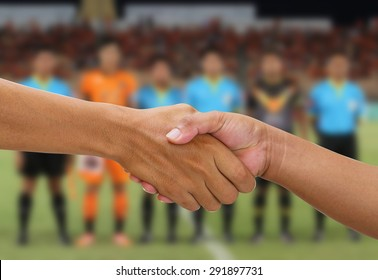 handshake in a business on referee with captain team and opponent team players shaking hand on football stadium background