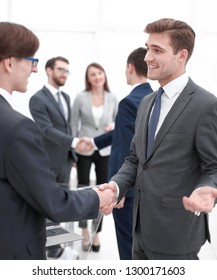 handshake of business partners after the briefing