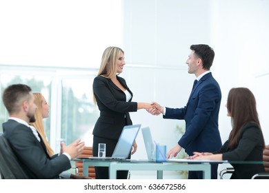 Handshake business partners after discussing the terms of the co