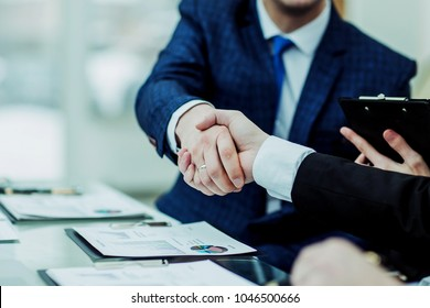 handshake business partners after discussion of the financial agreement