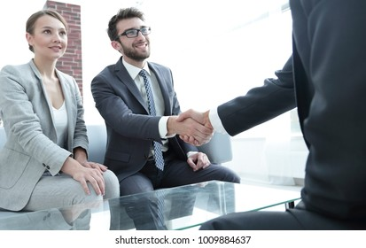 handshake business partners after a business meeting
