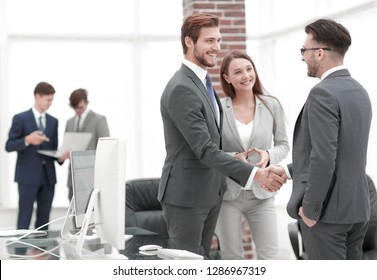 handshake business partners at a meeting