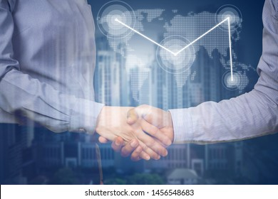 handshake business partners with virtual map link and business building, concept of business commitment.