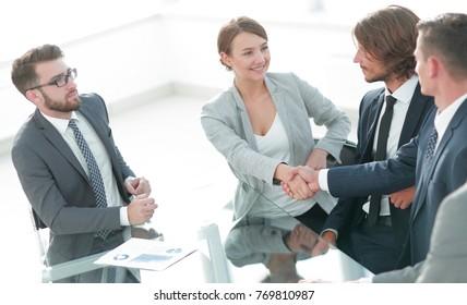 handshake business women with business partner