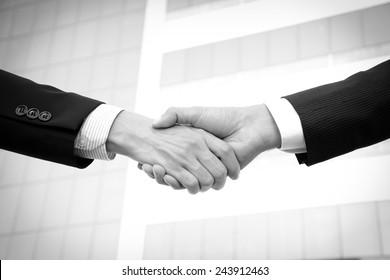 Handshake of businessmen, greeting, dealing, partnership, merger & acquisition concepts - monochrome effect