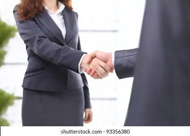Handshake businessmen in the office.