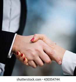 Handshake - classic business symbol, close-up