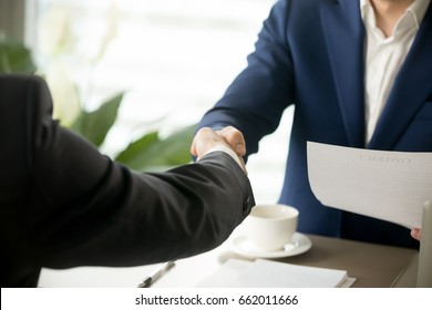 Handshake close up, male hands shaking after signing contract, businessmen making deal, accepting business offer, forming partnership, successful negotiations result, mutual agreement, help, support
