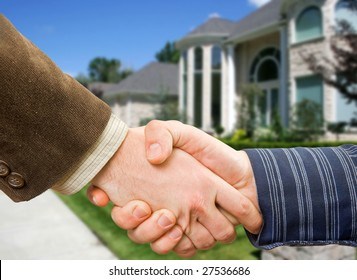 Handshake concept with house in background