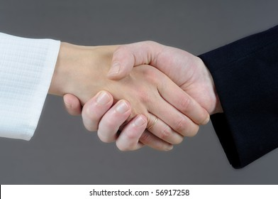 Handshake concept - male and female hand.