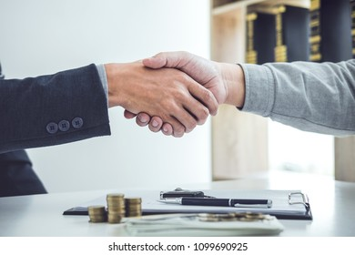 Handshake of cooperation customer and salesman after agreement, successful car loan contract buying or selling new vehicle.